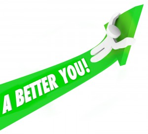 A Better You 3d words on a green arrow and a man riding it upward