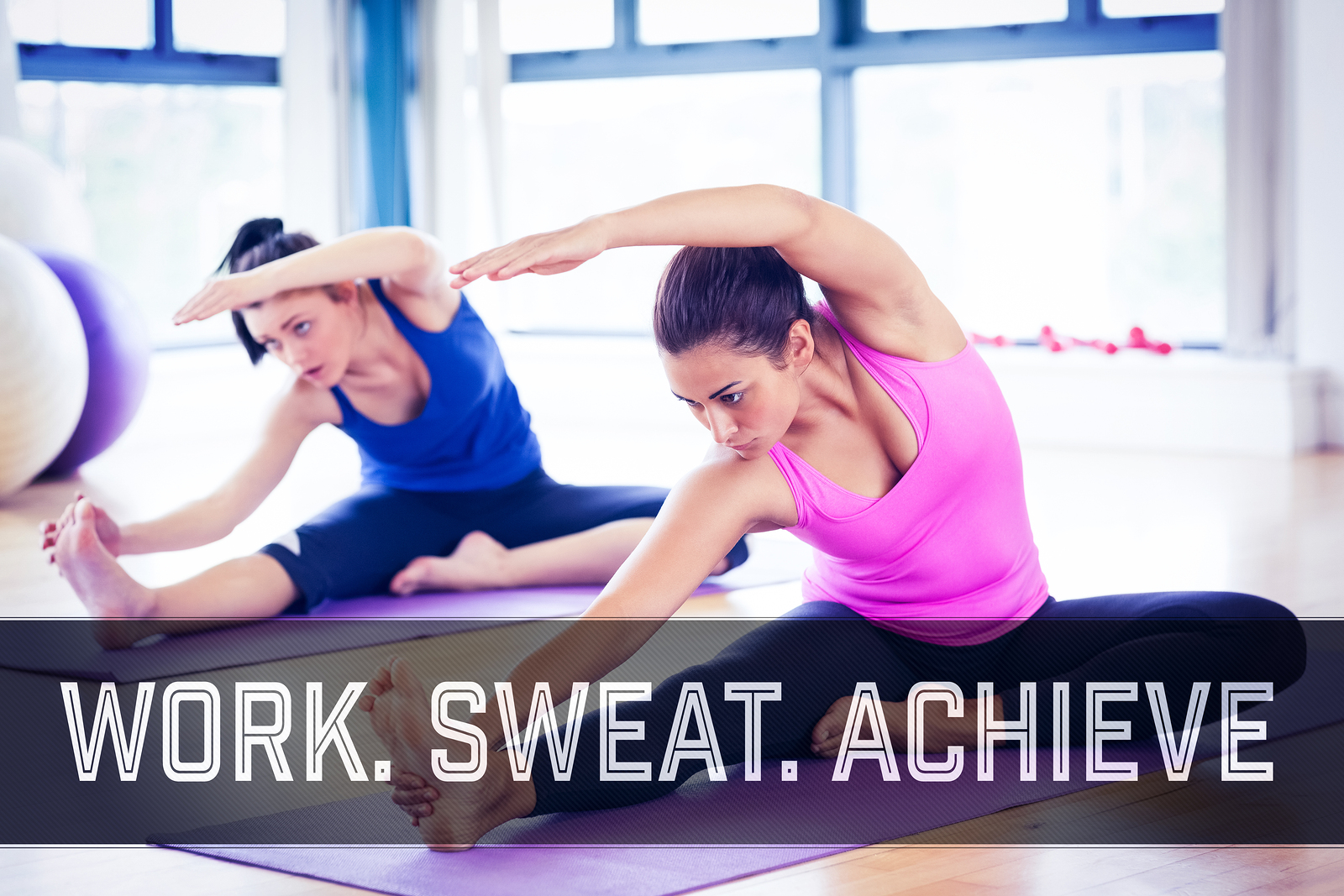 Fit women doing stretching pilate exercises against motivational words